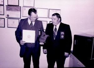 Black and white image of two officers receiving awards