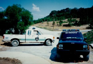 KCSO trucks parked on gravel road