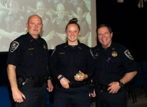 Sheriff, Chief Purvis, and new COTA graduate smiling