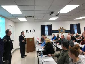 Sheriff and Chief Deputy speaking to COTA