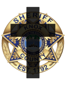KCSO badge with cross overlay