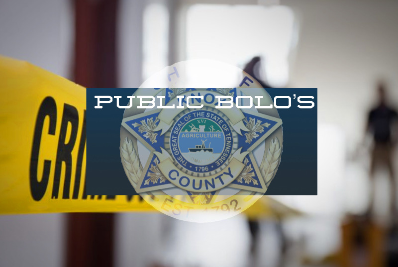 KCSO Badge over blurred crime background