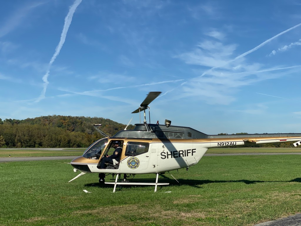 KCSO helicopter parked on grass