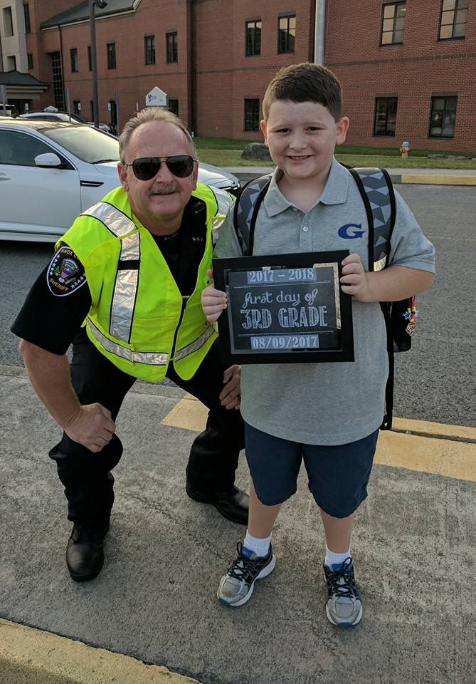 Chief deputy smiling with a 3rd grade boy