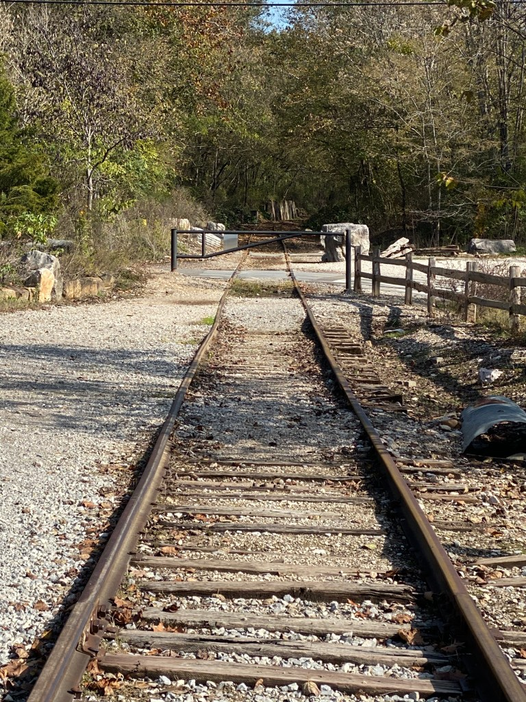 Railroad tracks near wooden fence