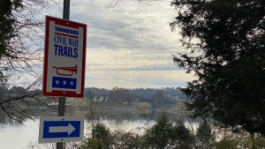 Trailway sign near overlooking river
