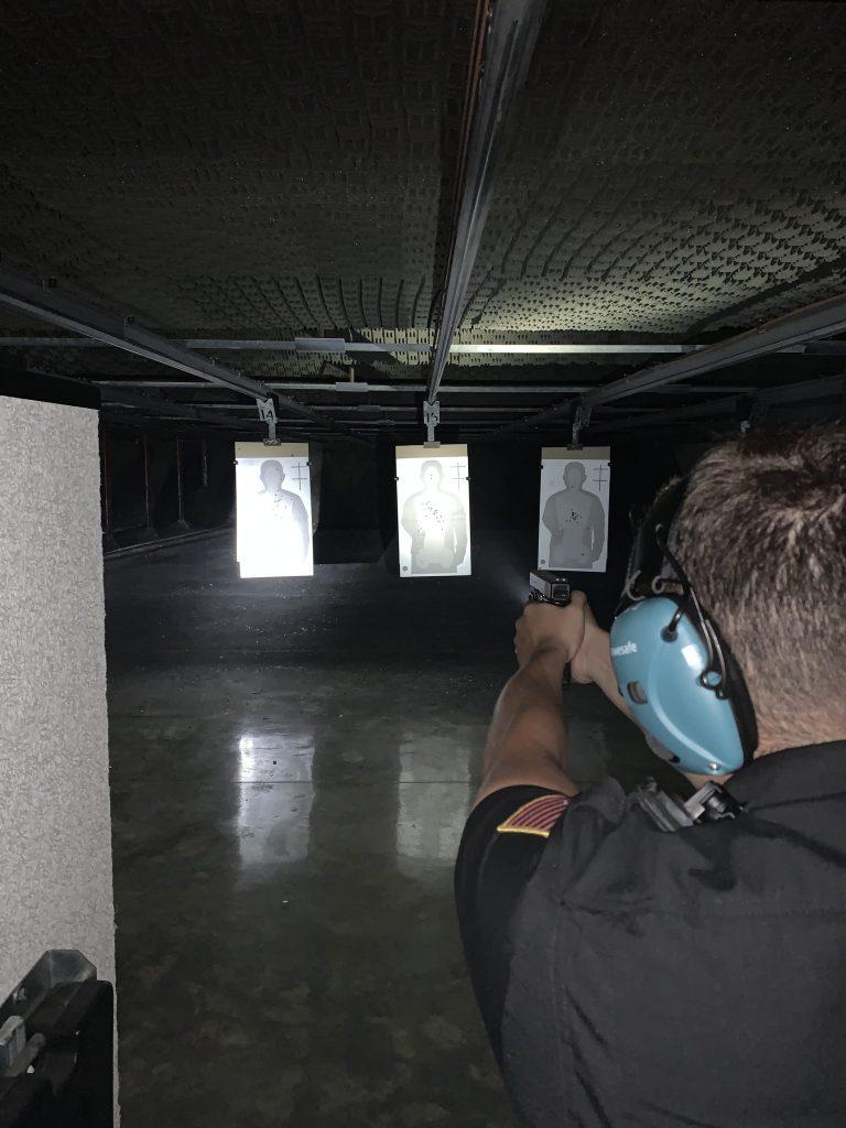 Recruit taking aim at indoor firing range