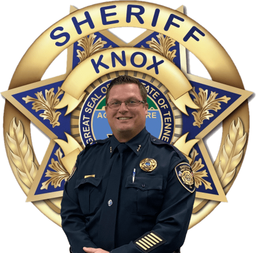 Chief workman in front of KCSO Badge