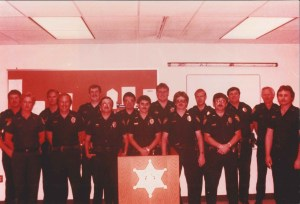 Older image of many deputies standing in rollcall