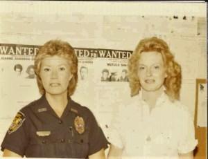 Older image of two female deputies, one in uniform