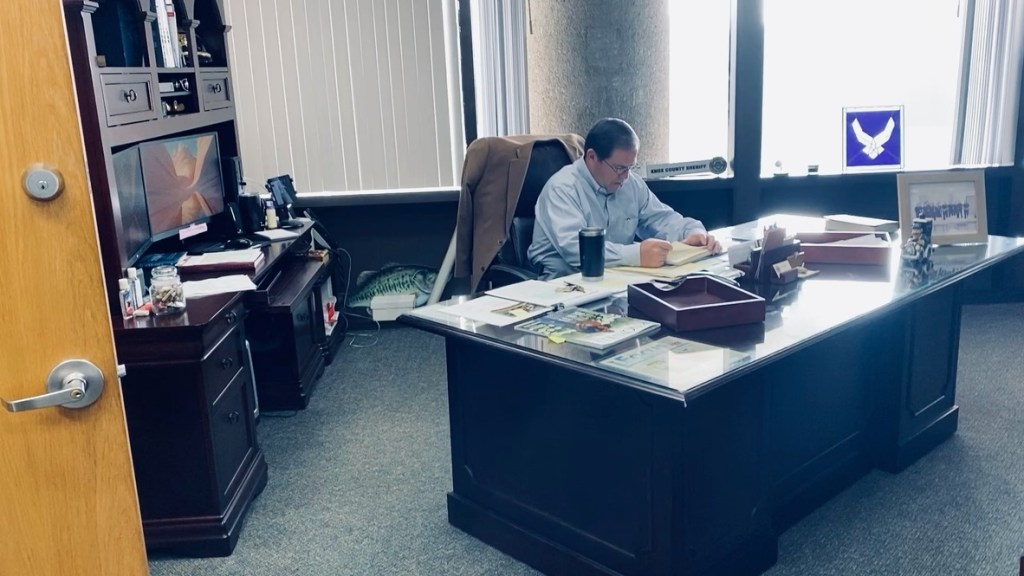Sheriff working at his desk