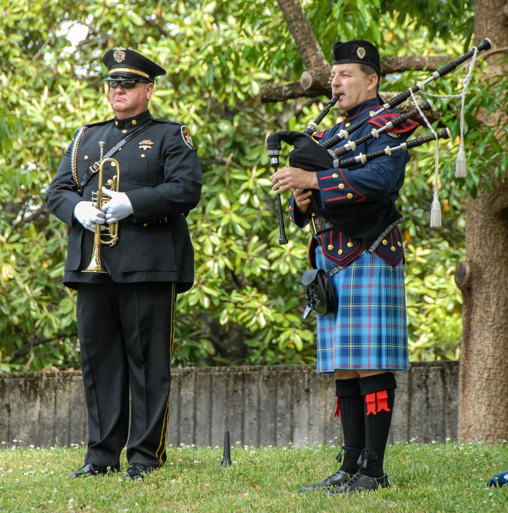 Honor guard trumpeter standing next to bag pipe player