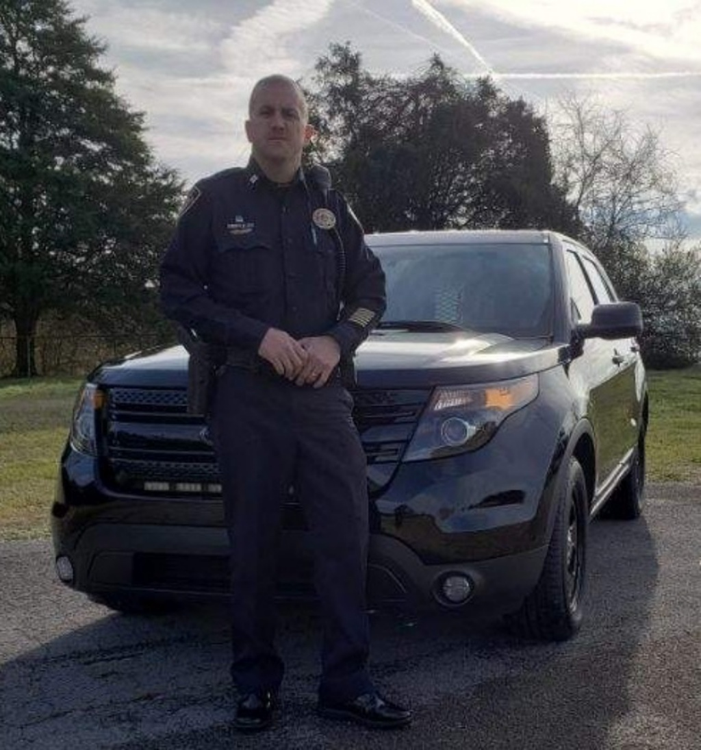 Captain Smith in front of black SUV