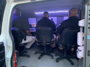 Negotiation officers sitting in mobile command center