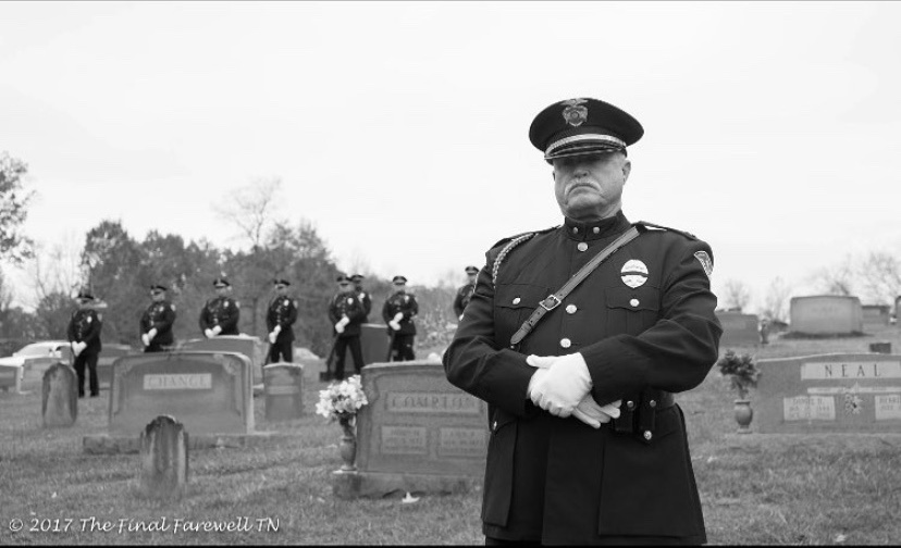 Black and white of Honor Guard standing at attention in graveyard