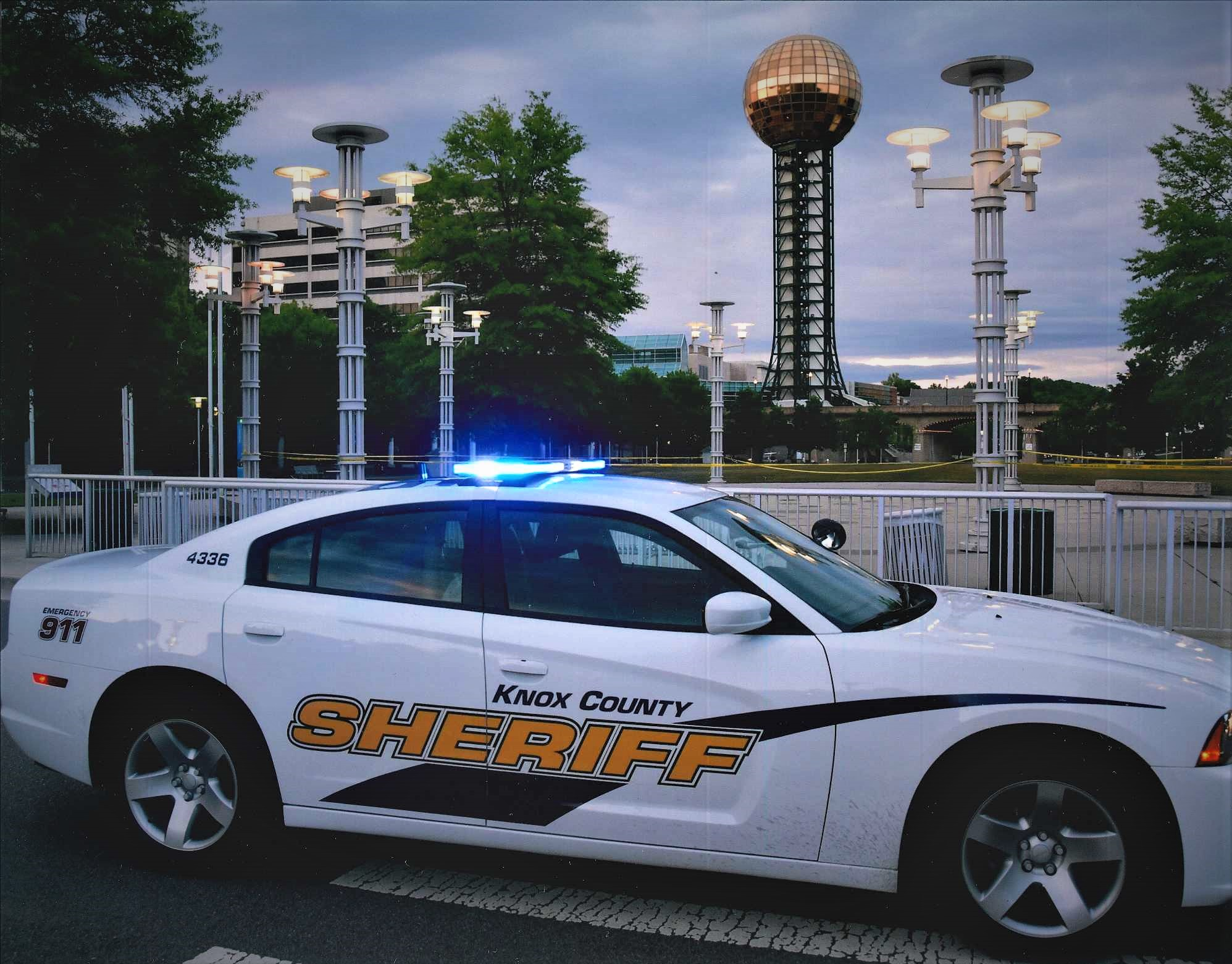 KCSO cruising parked in front of sunsphere with emergency lights on