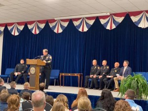 Chief Spangler speaking at a podium to a crowd