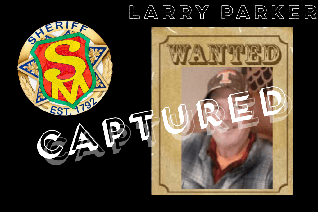 "Wanted poster of White male in UT hat and grey plaid shirt smiling and Safetyman badge with ""Captured"" overlay"
