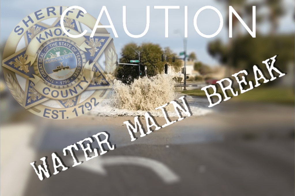 "Water break flowing from street with KCSO badge overlay and ""Water Main Break"""