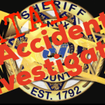 """Sheriff badge with crossing caution tape and """"Fatal accident investigation"""""""