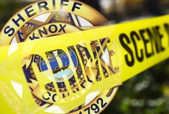 Crime Scene Tape diagonal over KCSO Badge