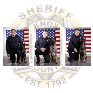 3 k9s with handlers kneeling over KCSO badge