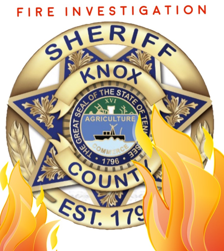"KCSO badge with flames in front and ""Fire Investigation"""