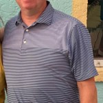 Smiling man in striped shirt