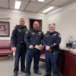 Corporal Thomas smiling with Chief Stephens and Captain Smith