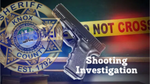 """Shooting Investigation"" with pistol, KCSO badge, and crime tape background"