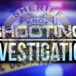 """Crime tape overlay with KCSO badge and """"Shooting Investigation"""""""