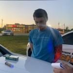 suspect standing near cruiser with cigarette