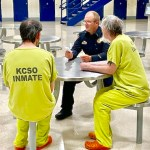 Officer Moyers sitting with inmates