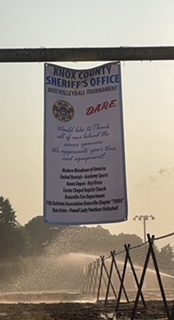 DARE sign at mud volleyball