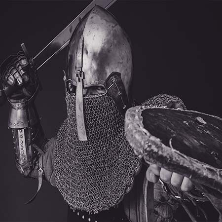 armored person with shield & sword drawn