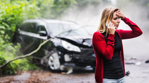 Woman on phone after crashing her car