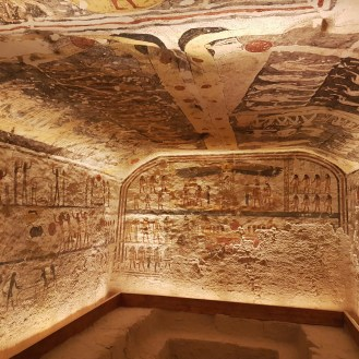 KV6 Rameses IX was built in Dynasty 20 and opened since antiquity. It has a large pit on the floor of the burial chamber. Check out the Book of Caverns; the Opening of the Mouth ritual; the Book of the Earth; the Book of the Day; the Book of the Night; the Imy-dwat; the Litany of Ra; and the Book of the Dead.