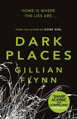 "The cover of ""Dark Places"" by Gillian Flynn. The title is in a lime green sans-serif font on a black back background, with a photo negative image of weeds in the bottom left corner."