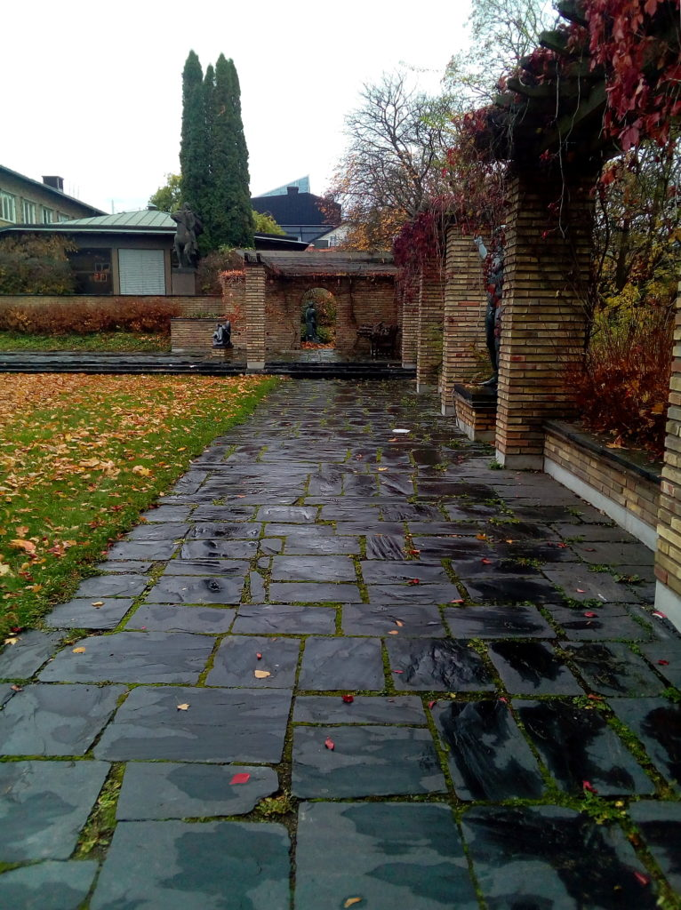 A slate walkway and some statuary at Marabouparken on a rainy, overcast day.