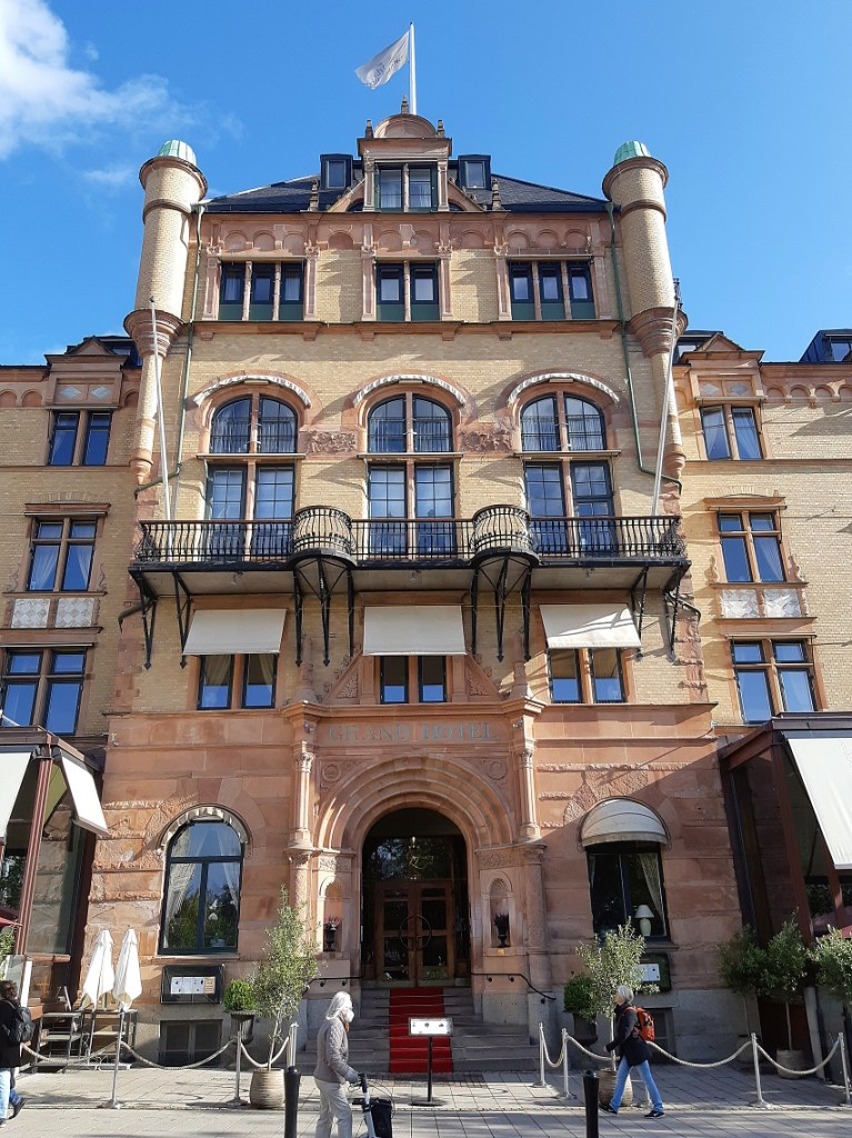 Exterior of a hotel in Lund on a sunny afternoon.