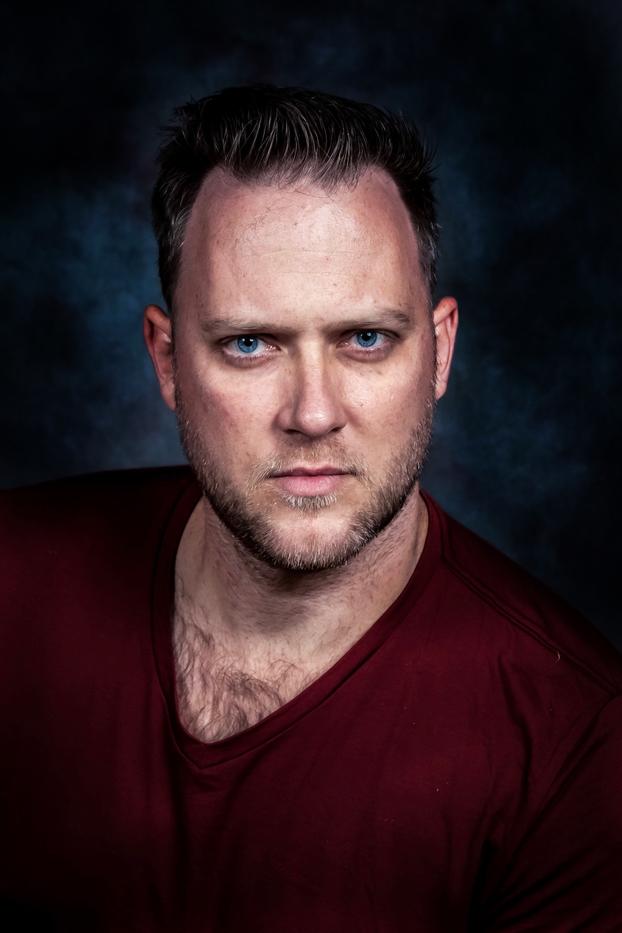 A headshot of Nick Thacker.