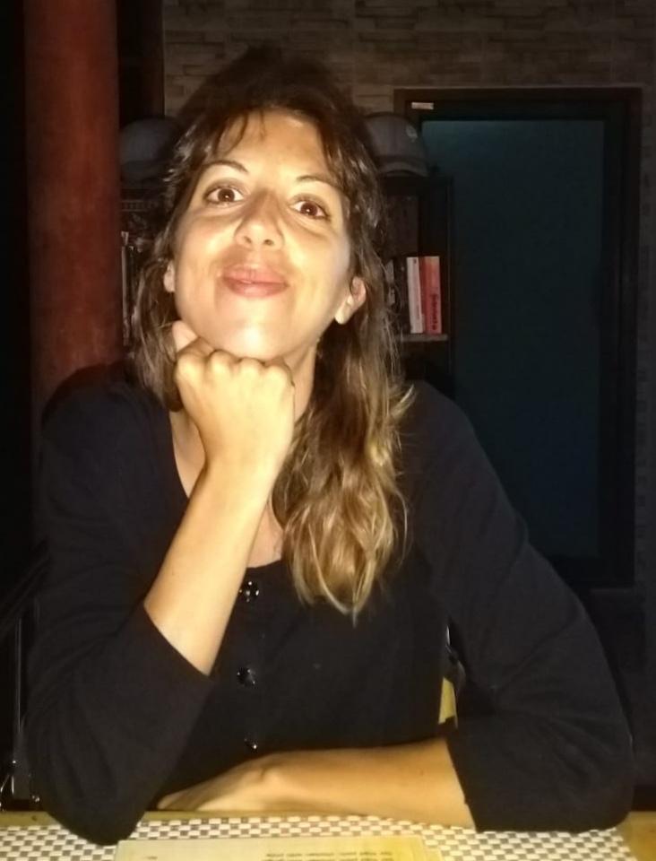 A headshot of Lucia.