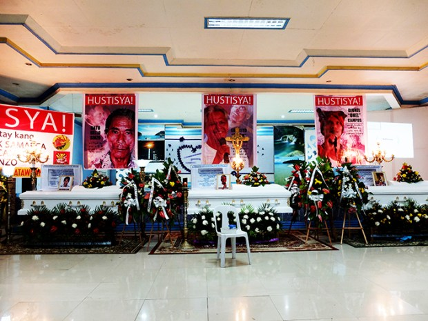 Unusual, yet regular, are the banners over coffins of extra-judicial killing victims in Mindanao, mostly lumads who defend their land from mining plunder, demanding justice.
