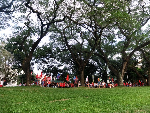 "The Unity Walk as it rounds the bend in front of the College of Economics where participants chanted ""Winnie, labas diyan!""  They were calling out Prof. Solita Monsod who repeatedly defended the Armed Forces of the Philippines over accusations it masterminded the killings of Lumad."