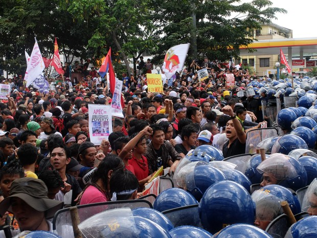 "The ""battle"" finally stopped after the police agreed to allow the protesters to hold their program at the site, several kilometers away from Liwasang Bonifacio where APEC security plans wanted to ""contain"" the protests."