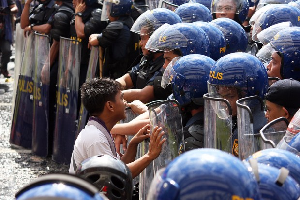 A youth activist tries to make the police understand why they should oppose the APEC as well.