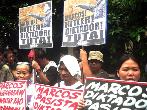 Rally at the Supreme Court protesting Marcos' burial at the LNMB revives old slogans against the former president.