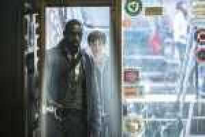 Roland (Idris Elba) and Jake (Tom Taylor) in Columbia Pictures' THE DARK TOWER.