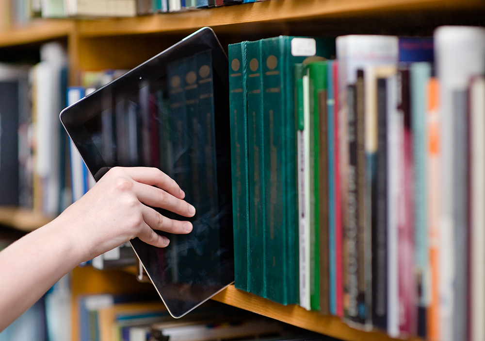 iPad in a bookshelf