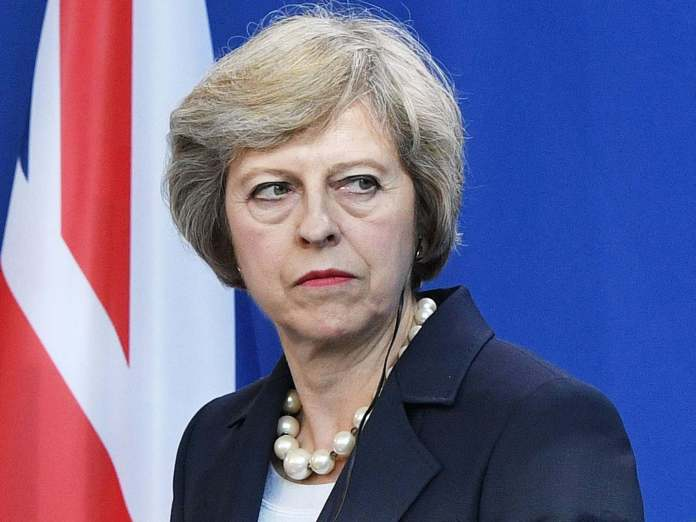 UK Prime Minister, Theresa May, Ban The Entire British Government From Attending The 2018 World Cup In Russia Over Spy Poisoning 1